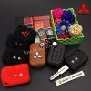 ซองหนังแท้ ใส่กุญแจรีโมทรถยนต์ รุ่นดอกกุญแจ โลโก้เหล็ก Mitsubishi Attrage,Triton แบบใหม่