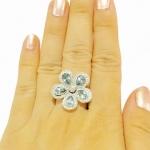 แหวนดอกไม้เพทายล้อมเพชร