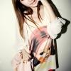 เสื้อแฟชั่นเกาหลี ลายเด็กน่ารัก สีครีมอ่อน ตัดต่อผ้าชีฟองช่วงแขนพองๆ จั๊มที่ข้อแขน