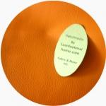 LH11 : หนังเทียมสีส้ม แบ่งขาย  1 หน่วย = ขนาด1/4 หลา : 45X 65 cm