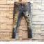 กางเกงยีนส์ผู้ชายขาดๆแฟชั่น thumbnail 2